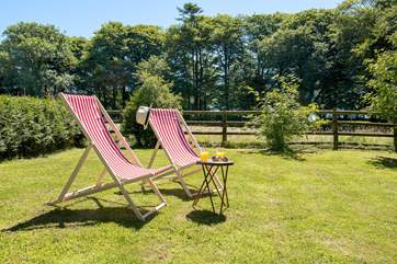 Deck chairs are provided for you to enjoy the garden.
