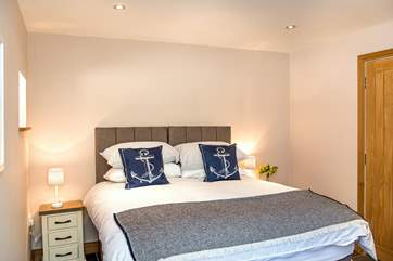 Bedroom 1 adopts a nautical theme - reminding you how close you are to the coast.