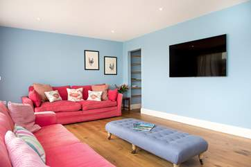 The sitting-room boasts a 62 inch TV so why not enjoy a holiday movie or two!