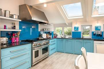 The bespoke kitchen has wonderful bright blue units and a fabulous range cooker - ideal when cooking for 12 guests.