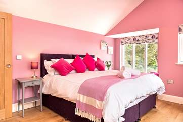 You'll be pretty in pink in bedroom 6. The bed can either be made up as a super-king size bed or twin beds.