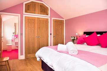To match the bedroom the pink theme carries on in the stylish shower-room.