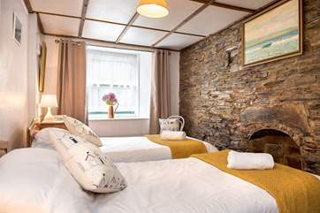 The twn bedroom is at the front of Haywain - it retains much of its original charm with the exposed wall.