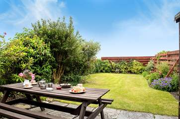 Adults can sit and enjoy a Cornish cream tea whilst younger members play on the lawn.