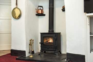The toasty wood-burner is a welcome sight on chillier evenings.