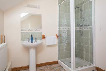 Family bathroom is equipped with a shower cubicle and a bath.