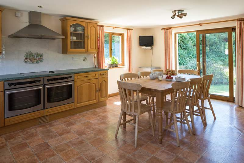 The kitchen is extremely spacious and well-equipped.