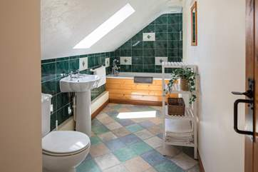 The family bathroom is a lovely place to slink back and relax immersed in a bath of bubbles.