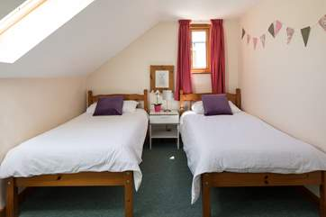 Bedroom 2 is an attractive twin room.