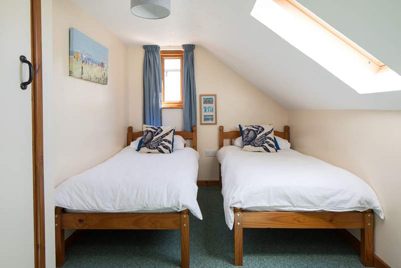 Bedroom 3 also offers these inviting twin beds.