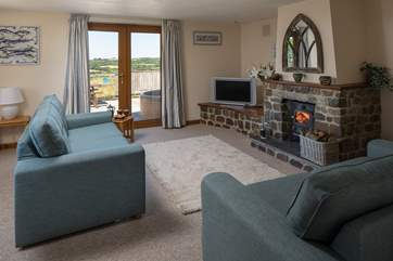 The wood-burner makes this inviting sitting-room the perfect place to snuggle up and enjoy a cosy night in.
