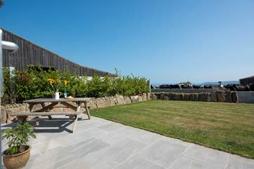 The enclosed garden has lovely views across countryside to Mount's Bay.