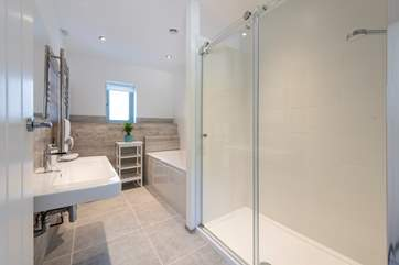 A nice big bath and a double shower in the family bathroom.