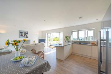 The kitchen area to the right, dining area to the left and the sitting area next to the French windows, allowing you to make the most of the sea views.