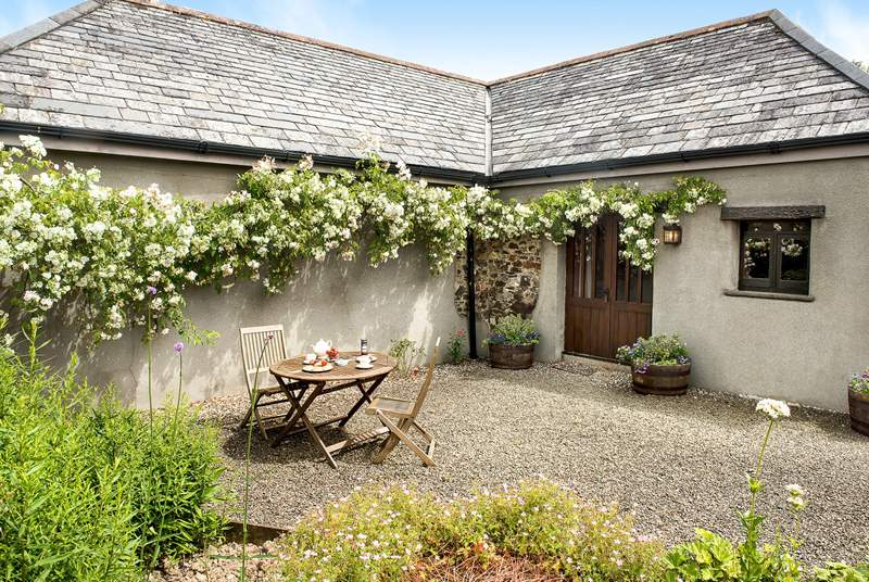 Welcome to Meadow Barn a gorgeous barn conversion for two with roses around the door.