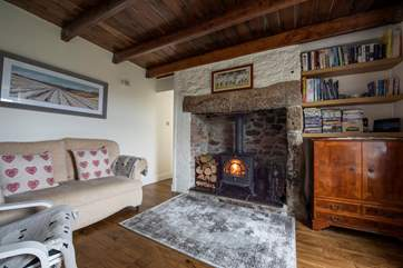 Relax in front of the roaring wood-burner.