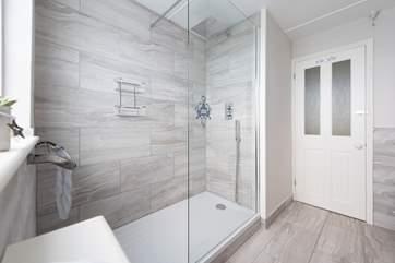 A huge walk-in shower in the ground floor shower-room.