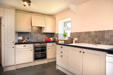The modern kitchen is very stylish and well-equipped