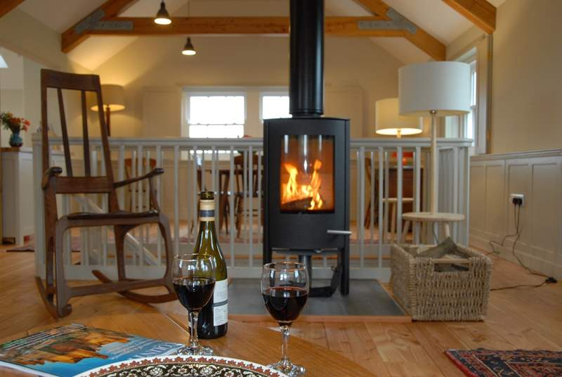 The gorgeous first floor open plan living area with a roaring wood-burner.