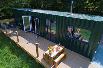 Relax and enjoy this fabulous setting in this beautifully and uniquely converted shipping container.