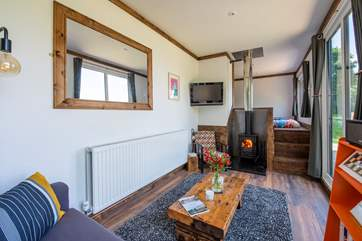 The open plan living-area is just gorgeous and if you ever get bored of the stunning views there is a TV with Amazon Firestick and a cosy wood-burner too.