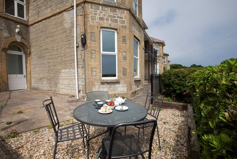 The terrace wraps around two sides of the property, the perfect spot to enjoy the evening sun