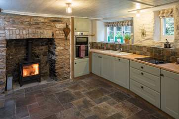 Even the kitchen has a top of the range wood-burning stove.