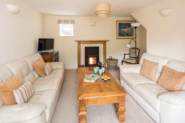 The comfortable sitting-room also has a wood-burner, which is perfect for those cosy nights in.
