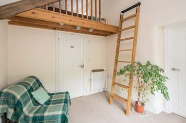 Bedroom 1 is on a raised platform. This single bed is the perfect retreat for that member of the party seeking total peace. Through the white door is the ground floor shower-room.