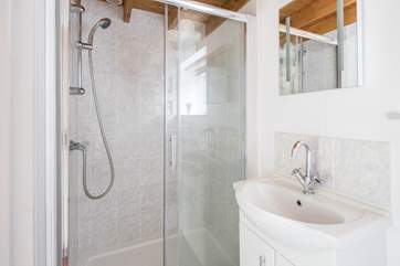 Ground floor shower-room with shower cubicle, WC and wash-basin.