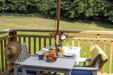 Al fresco dining can be enjoyed overlooking the peaceful meadow.