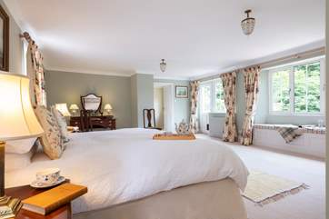 The master bedroom is dual aspect and has a lovely Juliet balcony with views over the garden.