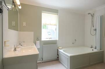 The en suite bathroom to Bedroom 2 has twin basins.