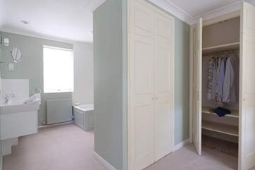The dressing-room to the master bedroom. Plenty of space to fit a cot if required.