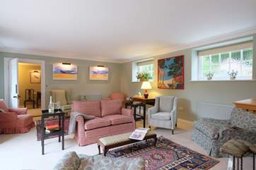 There is plenty of space for everyone to relax in the sitting-room.