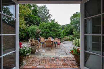 French doors open from the sitting-room to the terrace and garden.