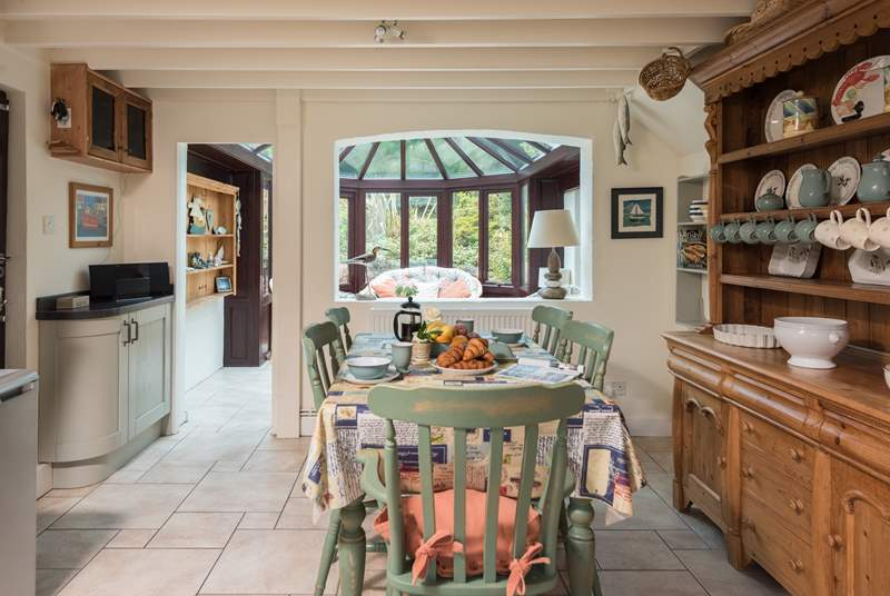 The kitchen/breakfast-room opens into the sociable conservatory.