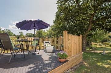 The raised decked area is a great place to enjoy mealtimes al fresco