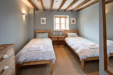 Bedroom 3 is home to these delightful twin beds.