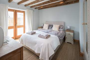 Bedroom 2 is a beautiful light and airy bedroom which leads out onto an enclosed courtyard and is home to a rather inviting king-size bed.