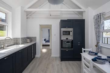 The compact and well-equipped kitchen/dining area.
