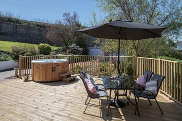 Whether you're in the hot tub, or enjoying a glass of something tasty under the brolly, this fabulous sized decking and ample seating provides a wonderful place to relax and unwind together.