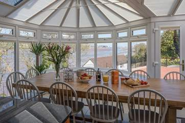 Wonderful water views can be enjoyed from this glorious dining-table.