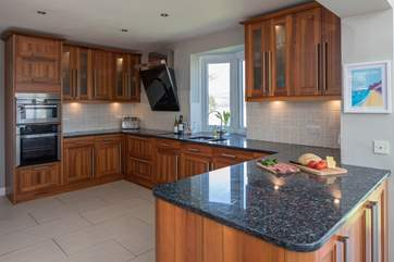 The well-equipped kitchen offers plentiful space to whip up a feast.