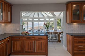 The large open plan kitchen/dining room. Step into the light and airy dining area and enjoy the views as you dine.