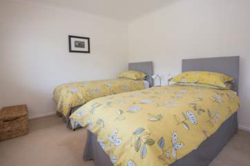 The tastefully decorated twin bedroom