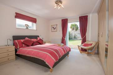 The master bedroom with doors leading to the pretty garden