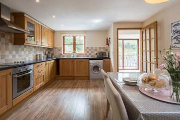 The spacious and well-equipped kitchen/diner is perfect for whipping up a feast.