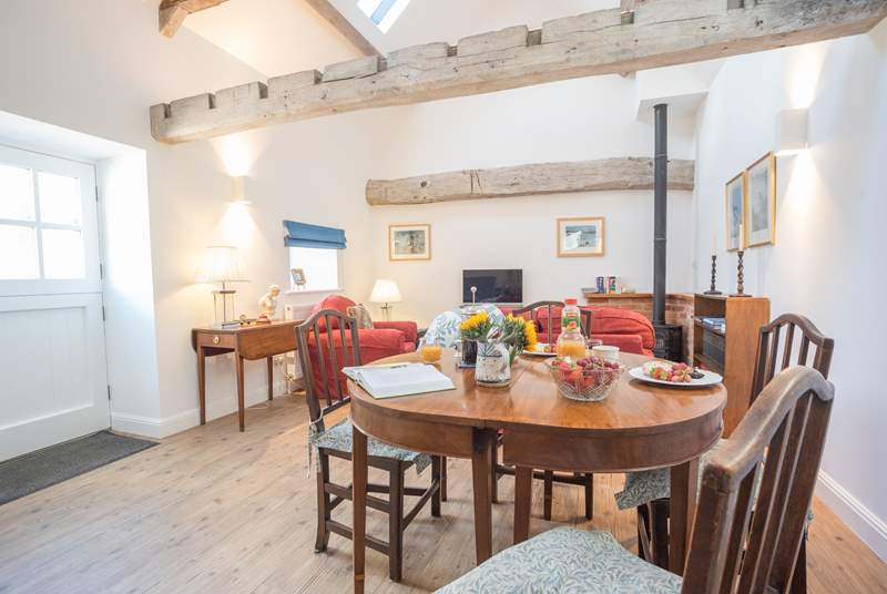 This spacious open plan barn conversion is full of character.