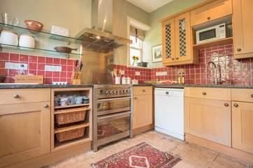 The flagstone flooring runs through into the kitchen.